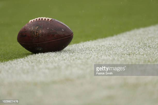 A football sits on the field during the game between the Baltimore Ravens and the Buffalo Bills at MT Bank Stadium on September 9 2018 in Baltimore...