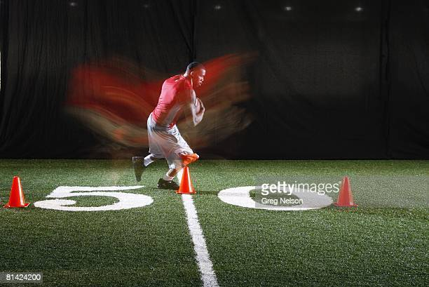 Football Slow shutter speed portrait of NFL prospect and former Arkansas RB Darren McFadden in Walker Pavilion at University of Arkansas Fayetteville...