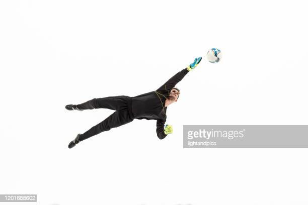 football, soccer in white studio - diving to the ground stock pictures, royalty-free photos & images