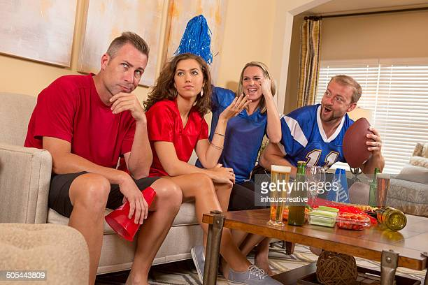 Football sports fans at home taunting each other