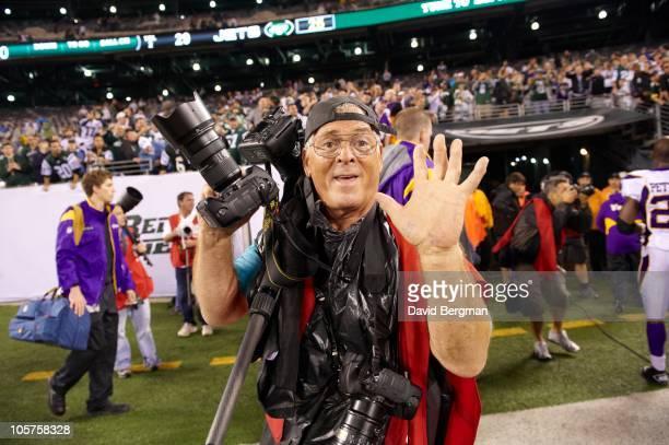 Sports Illustrated photographer John Iacono on sidelines after New York Jets vs Minnesota Vikings game. East Rutherford, NJ CREDIT: David Bergman