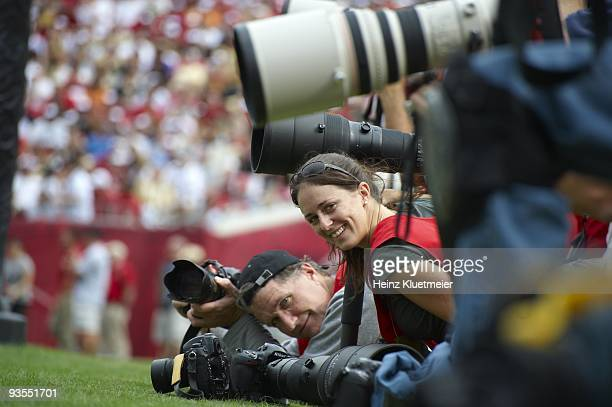 Sports Illustrated staff photographer Bill Frakes on sidelines during Tampa Bay Buccaneers vs New Orleans Saints game Tampa FL CREDIT Heinz Kluetmeier
