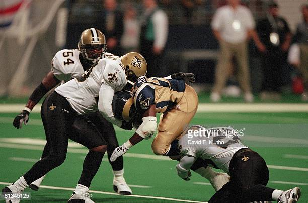 Football St Louis Rams Trung Canidate in action during tackle vs New Orleans Saints St Louis MO