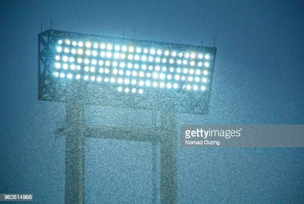 football stadium spotlight with heavy rain. - floodlit stock pictures, royalty-free photos & images
