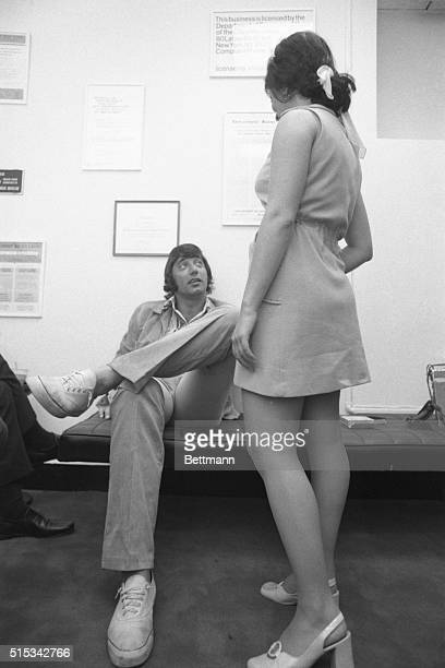 Football star Joe Namath whose latest line of business is an employment agency called 'MantleNamath' gives advice to a girl who is seeking a job The...