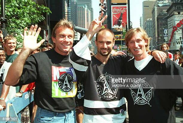Football star quarterback Joe Montana tennis star Andre Agassi and hockey great Wayne Gretzky stop and pose for photographers before the...