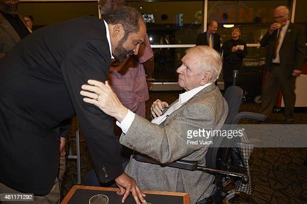 Steelers' Super Bowl Reunion View of former Pittsburgh Steelers player Franco Harris with former defensive line coach George Perles before roundtable...