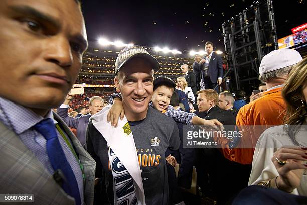 Super Bowl 50 Denver Broncos QB Peyton Manning victorious holding son Marshall after winning game vs Carolina Panthers at Levi's Stadium Santa Clara...