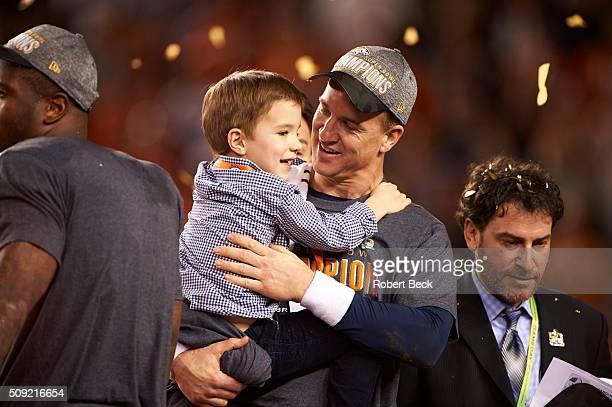 Super Bowl 50 Denver Broncos QB Peyton Manning victorious with son Marshall after winning game vs Carolina Panthers at Levi's Stadium Santa Clara CA...