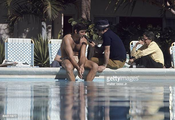 Casual portrait of New York Jets QB Joe Namath being interviewed near pool before Super Bowl III vs Baltimore Colts. Fort Lauderdale, FL 1/10/1969...