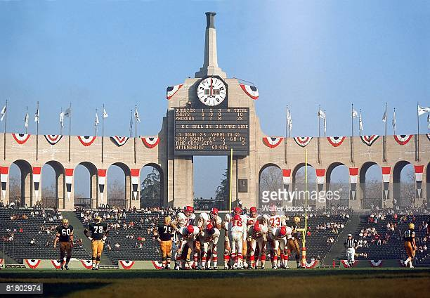 Football Super Bowl I Kansas City Chiefs in huddle during game vs Green Bay Packers View of scoreboard at Memorial Coliseum Los Angeles CA 1/15/1967