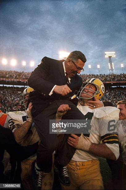 Football Super Bowl II Green Bay Packers coach Vince Lombardi victorious getting carried off field by Jerry Kramer after game vs Oakland Raiders at...