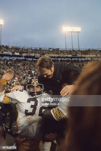 Super Bowl IX Pittsburgh Steelers coach Chuck Noll victorious getting carried off field by Franco Harris and Mean Joe Greene after winning game vs...