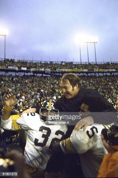Football Super Bowl IX Pittsburgh Steelers coach Chuck Noll victorious getting carried off field by Franco Harris and Mean Joe Greene after winning...