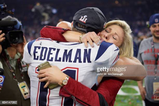 Super Bowl LI Closeup rear view of New England Patriots Julian Edelman victorious hugging his mother Angie after winning game vs Atlanta Falcons at...