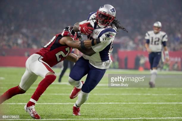 Super Bowl LI New England Patriots LeGarrette Blount in action rushing vs Atlanta Falcons Robert Alford at NRG Stadium Houston TX CREDIT Simon Bruty