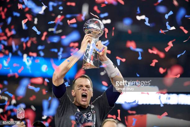 Super Bowl LI New England Patriots QB Tom Brady victorious holding up Vince Lombardi Trophy after winning game vs Atlanta Falcons at NRG Stadium...