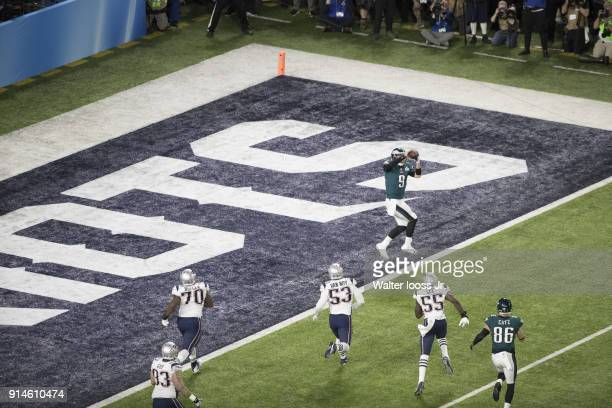 Super Bowl LII Aerial rear view of Philadelphia Eagles QB Nick Foles in action making touchdown catch vs New England Patriots at US Bank Stadium...