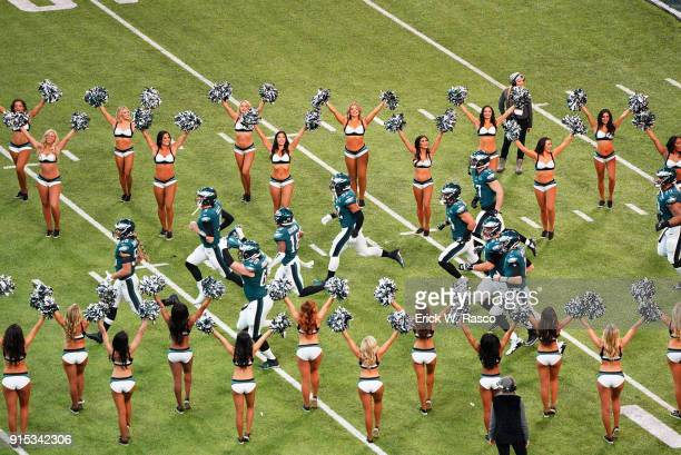 Super Bowl LII Aerial view of Philadelphia Eagles players taking field with cheerleaders surrounding them before game vs New England Patriots at US...