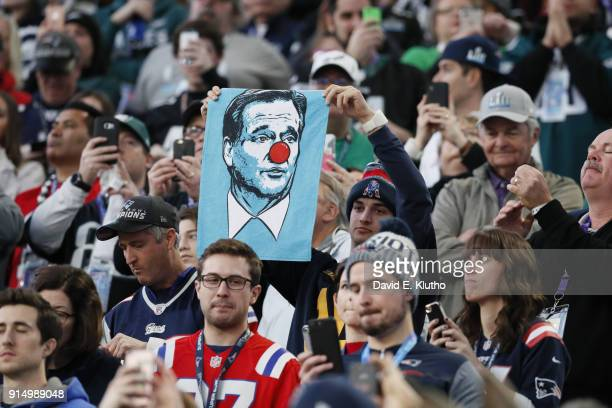 Super Bowl LII New England Patriots fan in stands holding up poster of NFL commissioner Roger Goodell wearing a red nose during game vs Philadelphia...
