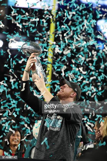 Super Bowl LII Philadelphia Eagles QB Carson Wentz victorious holding Vince Lombardi trophy after winning game vs New England Patriots game at US...