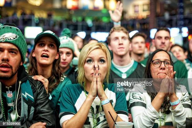 Super Bowl LII Street Scenes Closeup of Philadelphia Eagles fans watching game vs New England Patriots in bar Philadelphia PA CREDIT Rob Tringali