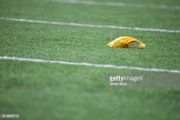Super Bowl LII View of yellow penalty flag on field during Philadelphia Eagles vs New England Patriots game vs at US Bank Stadium Minneapolis MN...