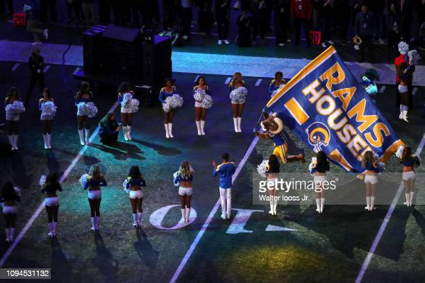 Super Bowl LIII Aerial view of Los Angeles Rams mascot Rampage exiting tunnel onto field with team flag before game vs New England Patriots at...