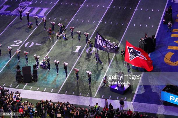Super Bowl LIII Aerial view of New England Patriots personnel exiting tunnel onto field with flags and banner before game vs Los Angeles Rams at...
