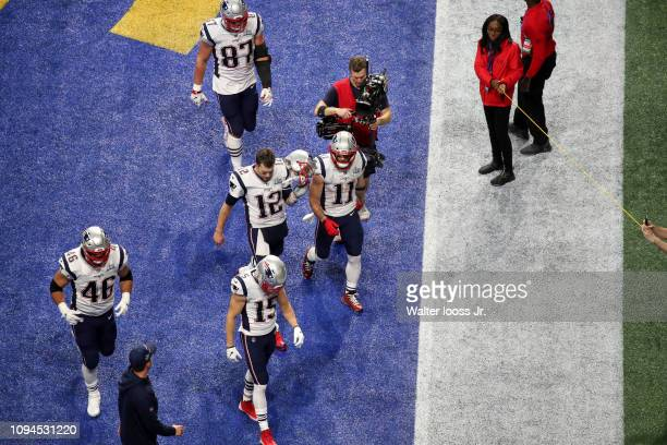 Super Bowl LIII Aerial view of New England Patriots QB Tom Brady and teammates walking off field during game vs Los Angeles Rams at MercedesBenz...