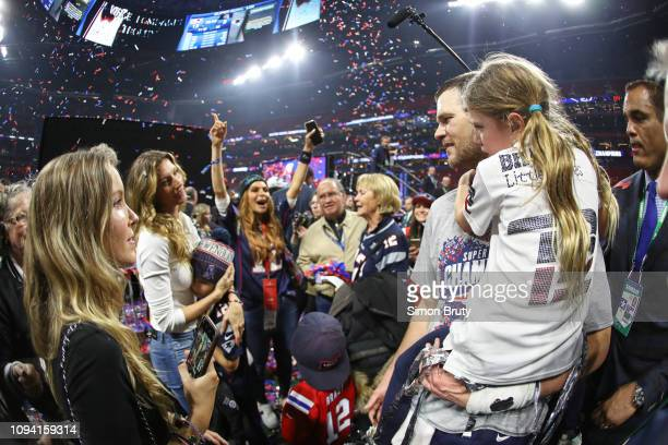 Super Bowl LIII New England Patriots QB Tom Brady victorious holding his daughter Vivian and looking at wife Gisele after winning game vs Los Angeles...