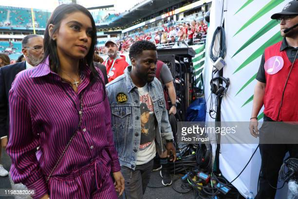 Super Bowl LIV Actor and comedian Kevin Hart with wife Eniko going into runway before San Francisco 49ers vs Kansas City Chiefs game at Hard Rock...