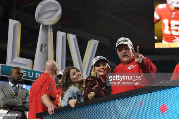 Super Bowl LIV Kansas City Chiefs coach Andy Reid victorious on stage with wife Tammy after winning game vs San Francisco 49ers at Hard Rock Stadium...