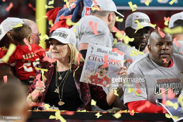 Super Bowl LIV Kansas City Chiefs coach Andy Reid's wife Tammy holding up newspaper with QB Patrick Mahomes on front page after winning game vs San...