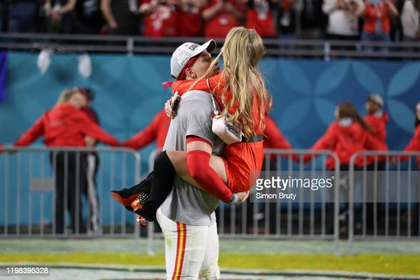Super Bowl LIV Kansas City Chiefs QB Patrick Mahomes victorious with his girlfriend Brittany Matthews after winning game vs San Francisco 49ers at...