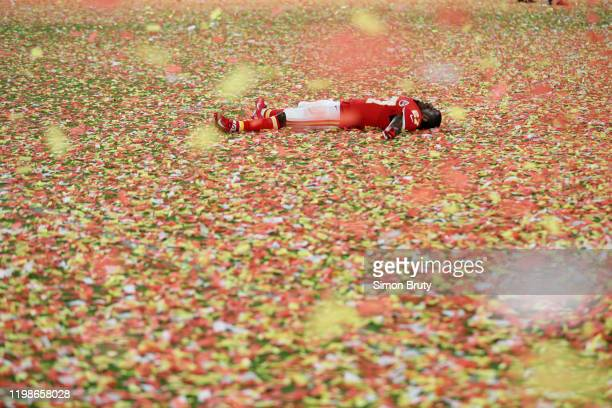 Super Bowl LIV: Kansas City Chiefs Rashad Fenton victorious laying down on confetti covered field after winning game vs San Francisco 49ers at Hard...
