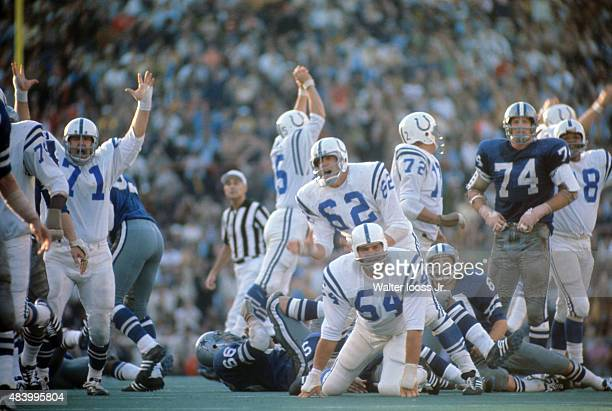 Super Bowl V Baltimore Colts Tom Goode and Glenn Ressler watch as teammate Jim O'Brien scores 32yard game winning field goal kick vs Dallas Cowboys...