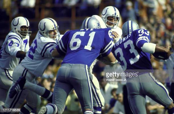 Super Bowl V Rear view of Dallas Cowboys Duane Thomas in action vs Baltimore Colts Mike Curtis and Ted Hendricks at Orange Bowl Stadium Miami FL...