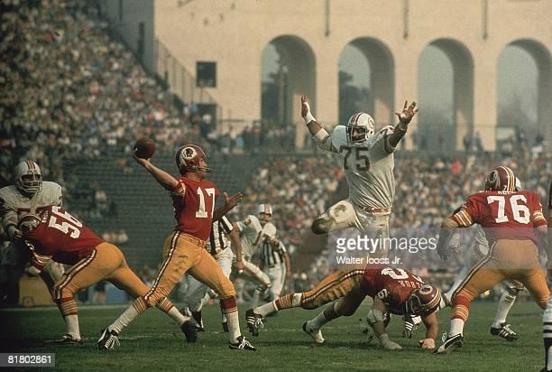 Football Super Bowl VII Miami Dolphins Manny Fernandez in action vs Washington Redskins QB Billy Kilmer Los Angeles CA 1/14/1973