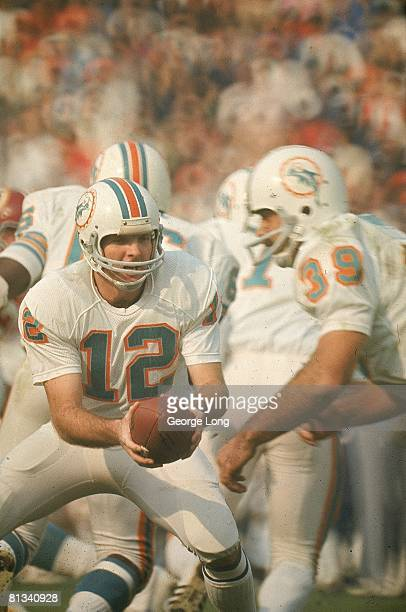 Football Super Bowl VII Miami Dolphins QB Bob Griese in action making handoff to Larry Csonka during game vs Washington Redskins Los Angeles CA...