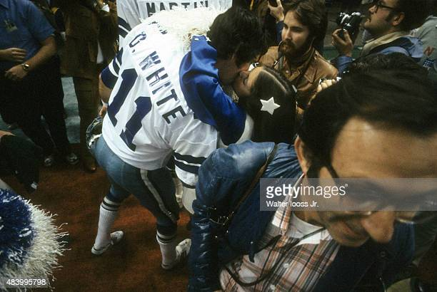 Super Bowl XII Dallas Cowboy backup QB Danny White victorious kissing cheerleader after winning game vs Denver Broncos at Louisiana Superdome New...