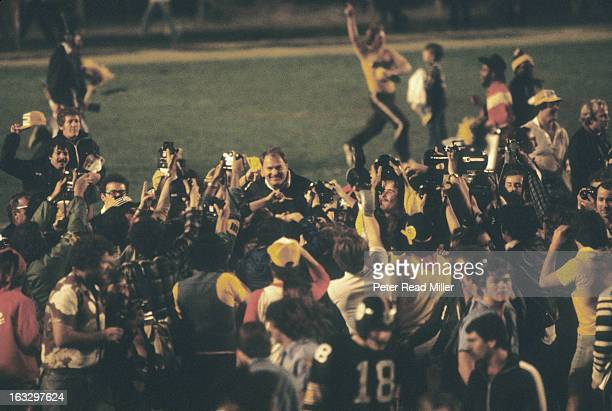 Super Bowl XIII Pittsburgh Steelers head coach Chuck Noll victorious surrounded by members of the media after winning game vs Dallas Cowboys at...