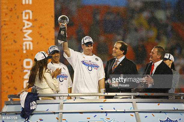 Football Super Bowl XLI Indianapolis Colts QB Peyton Manning victorious with Vince Lombardi trophy and coach Tony Dungy wife Lauren Dungy CBS Sports...