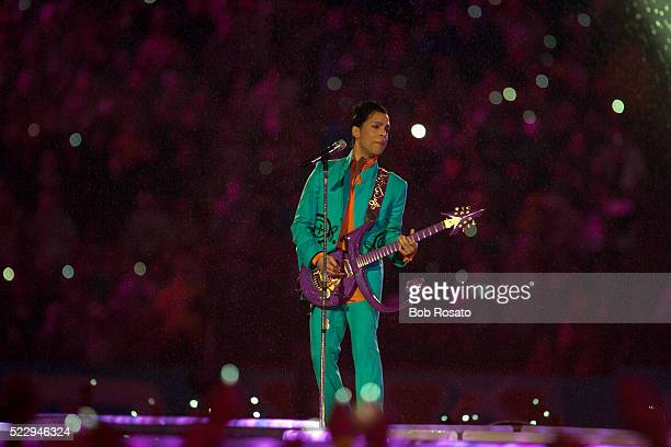 Super Bowl XLI Singer Prince performing halftime show during Indianapolis Colts vs Chicago Bears game at Dolphin Stadium Weather rain Miami FL CREDIT...