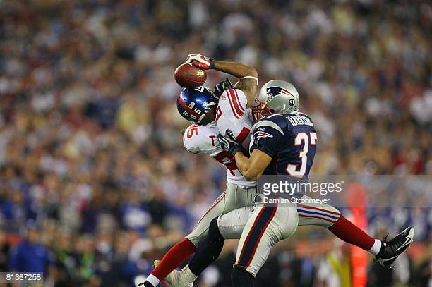 Football Super Bowl XLII New York Giants David Tyree in action making catch using helmet during 4th quarter vs New England Patriots Rodney Harrison...