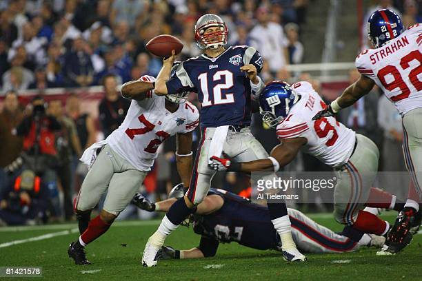 Football Super Bowl XLII New York Giants Justin Tuck and Osi Umenyiora in action forcing fumble vs New England Patriots QB Tom Brady Glendale AZ...
