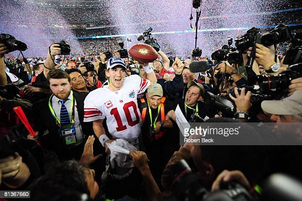 Football Super Bowl XLII New York Giants QB Eli Manning victorious surrounded by media after winning game vs New England Patriots Glendale AZ 2/3/2008