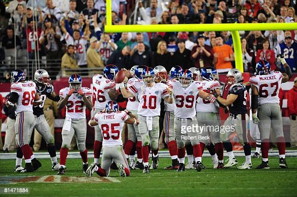 Football Super Bowl XLII New York Giants QB Eli Manning victorious during celebration with David Tyree after taking final snap and winning game vs...