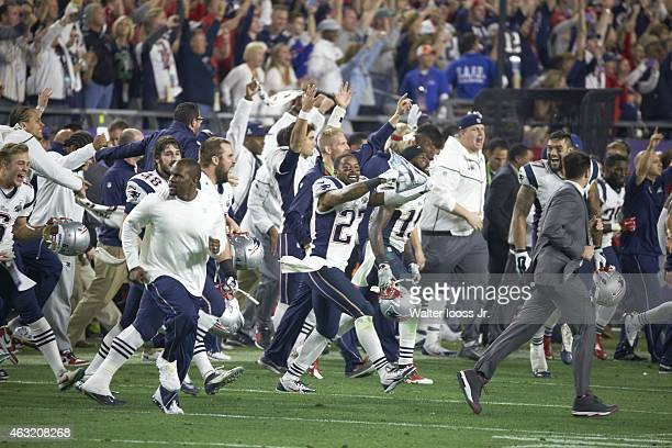 Super Bowl XLIX New England Patriots Tavon Wilson and teammates victorious during celebration after winning game vs Seattle Seahawks at University of...