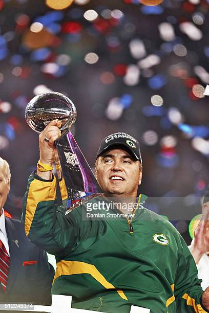 Super Bowl XLV Closeup of Green Bay Packers head coach Mike McCarthy victorious holding Vince Lombardi Trophy after winning game vs Pittsburgh...